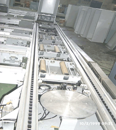 BUFFER STORAGE CONVEYOR TRANSFER SYSTEM
